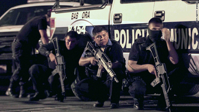State and federal police officers respond during a shootout at a prison in Ciudad Juarez, Mexico.