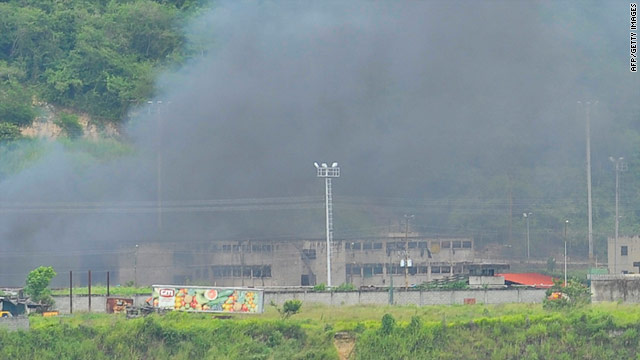 Smoke covers Rodeo I prison in Guatire, Venezuela during a prison standoff between inmates and the national guard in July.