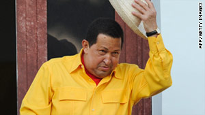 Venezuelan President Hugo Chavez salutes from a balcony of  in Caracas last month.