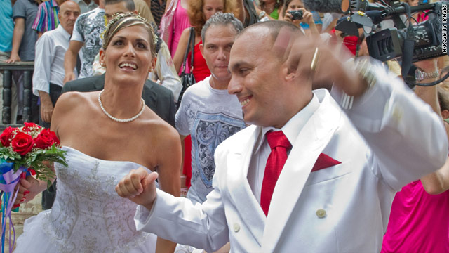 Transsexual bride Wendy Iriepa, left, and her groom Ignacio Estrada leave their Havana ceremony on August 13 in the first transsexual wedding in Cuba.