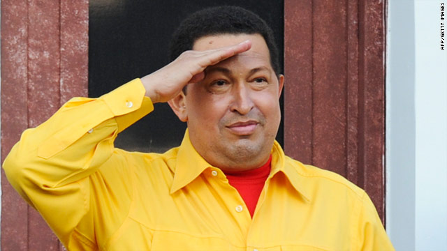 Hugo Chavez salutes from a balcony of the Miraflores presidential palace in Caracas on July 28.