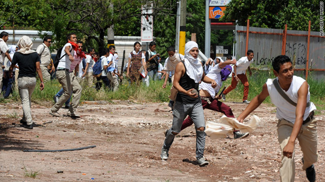 Students confront soldiers in a protest in Tegucigalpa on Tuesday. Soldiers also are trying to stop clashes in northern Honduras.