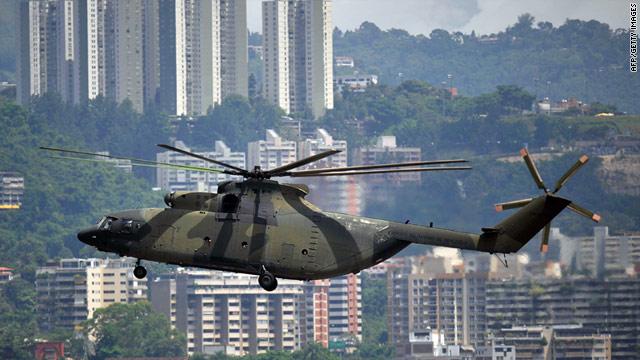 http://i.cdn.turner.com/cnn/2011/WORLD/americas/08/18/venezuela.plane.crash/t1larg.venezuela.helicopter.jpg