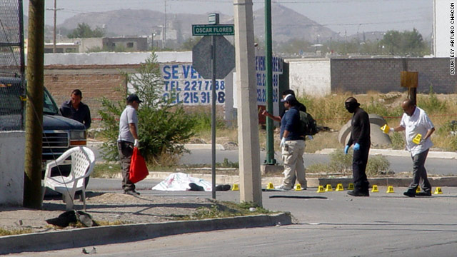 The crime scene in Cuidad Juarez -- where Cmdr. Mario Martin Favela Portillo, 25, was shot -- is marked by officers.