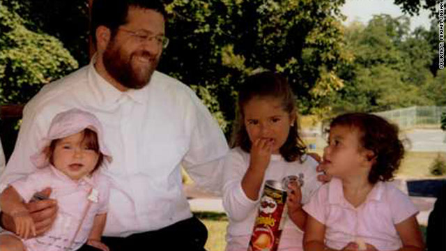 Jacob Ostreicher, seen with three of his 10 grandchildren, hopes to be home in New York for Rosh Hashanah later this month
