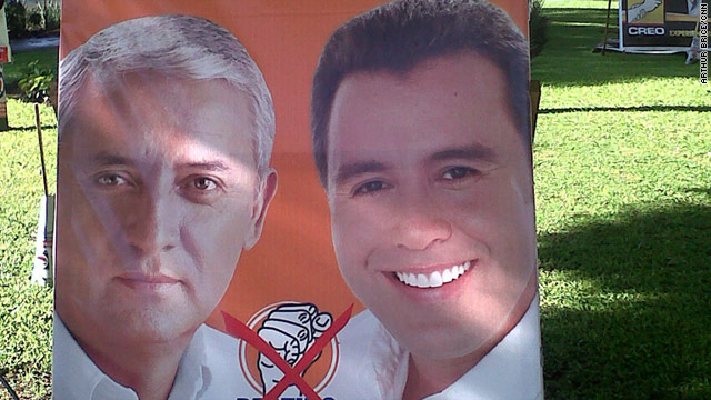 A campaign sign for Otto Perez Molina, left, who is leading in the polls in Guatemala's presidential election.