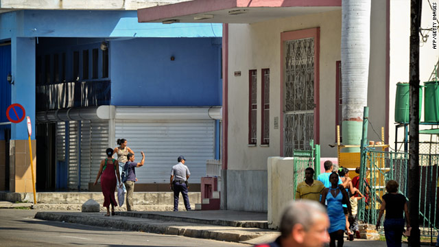 Cuban police keep a street closed near the church (R) where more than 60 believers remain in spiritual retreat in Havana.