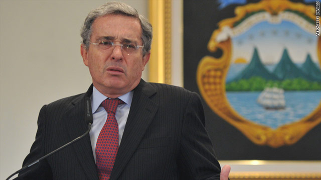 Alvaro Uribe, speaking at a press conference in August, denies he ordered his political opponents to be wiretapped.