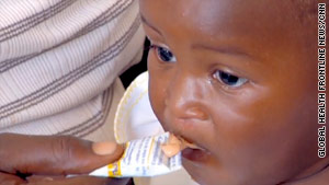 A Haitian child is given Nutributter, a supplementary food rich in nutrients.