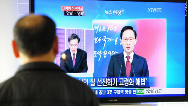 A man watches a broadcast of South Korean President Lee Myung-Bak's New Year policy address in Seoul on Monday.
