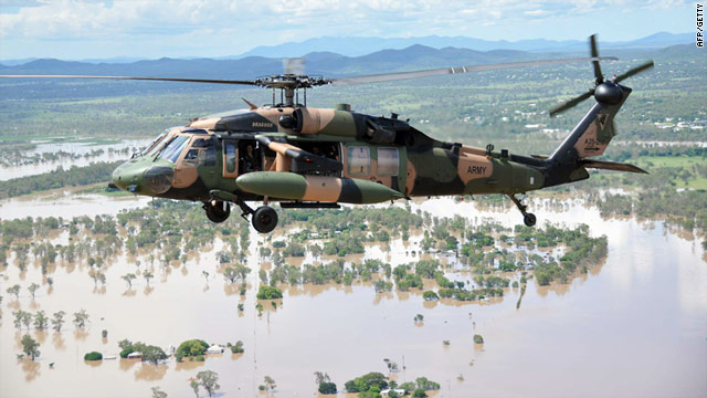 Australian PM Julia Gillard flies in an army helicopter to view the flooded Fitzroy River in Rockhampton on January 8, 2011.