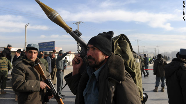 Heavily armed Afghan policemen stand guard at the site of a suicide bombing in Kabul in December, 2010.