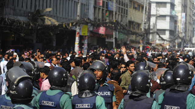 Angry protesters blocked traffic and burned furniture in front of the Dhaka Stock Exchange in Bangladesh on Monday.