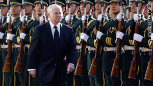 U.S. Secretary of Defense Robert Gates walks past a Chinese honor guard during his visit to Beijing on Tuesday.