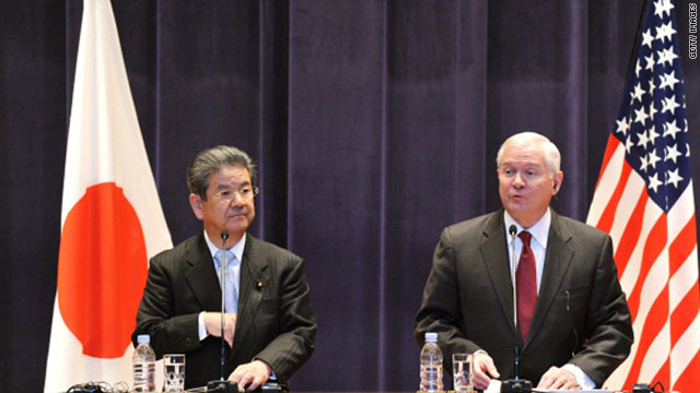 US Defense Secretary Robert Gates, right, answers reporters' questions during a press conference with Japanese Defense Minister Toshimi Kitazawa, left, at the Ministry of Defense in Tokyo on Friday.