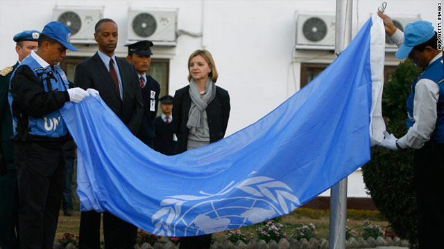 United Nations staff fold the U.N. flag in Kathmandu, Nepal, on Friday as U.N. envoy Karin Landgren, second from right, watches.