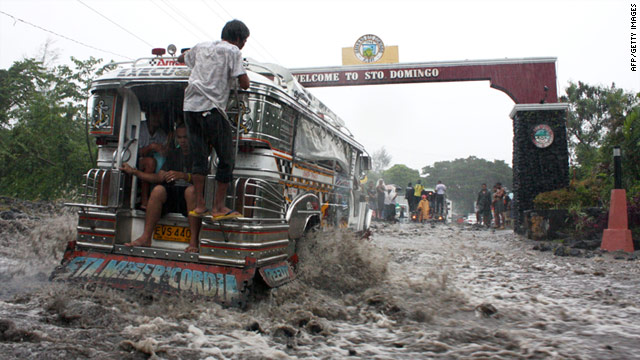 A passenger jeepney traverses a flooded road in the town of Sto. Domingo, southeast of Manila on December 30, 2010.