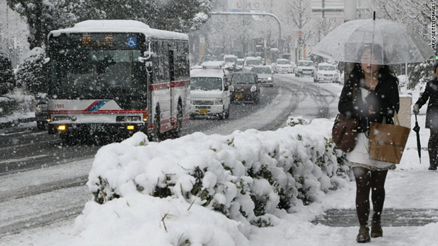 A pedestrian walks in a heavy snowfall in Nagoya in Aichi prefecture, central Japan on Monday.