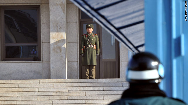 A North Korean soldier (C) and a South Korean soldier (R) stand guard in the Demilitarized Zone on Wednesday.