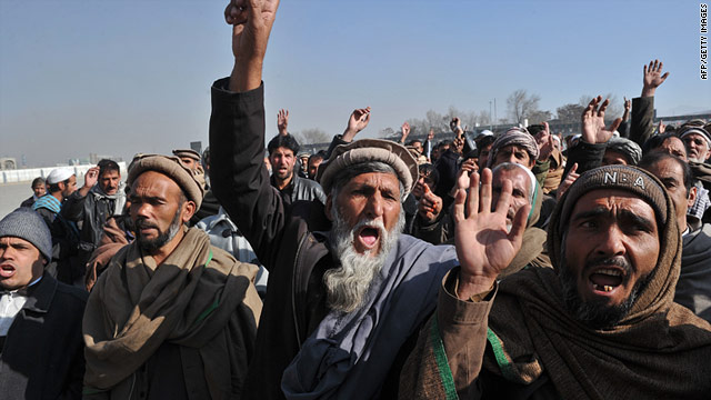 Afghan men shout slogans during a demonstration against paliamentary election results in Kabul on January 23, 2011.