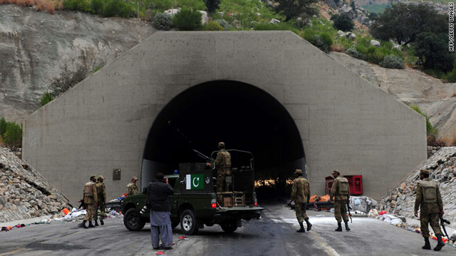 Pakistani soldiers patrol outside a tunnel following twin bombings in Kohat on Saturday that killed at least seven people.