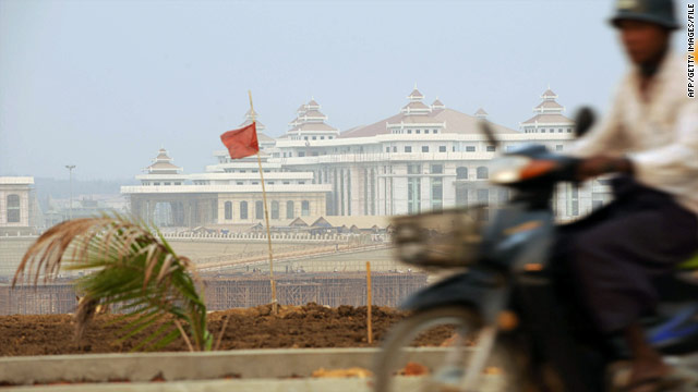 A man rides his motorcycle past Myanmar's new parliament in Naypyidaw in this file picture.