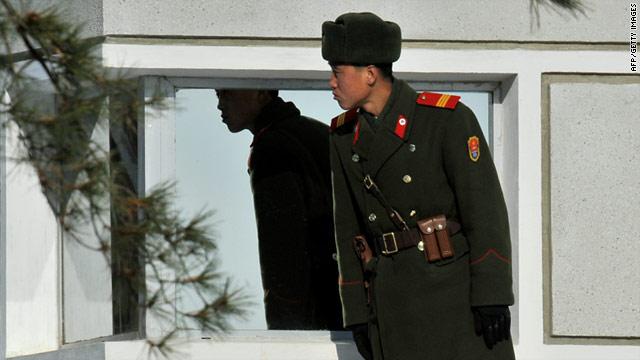 A North Korean soldier stands guard in the Demilitarized Zone separating the two Koreas on January 19, 2011.