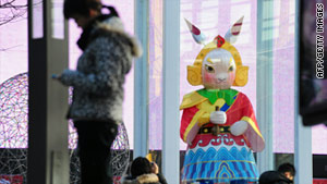 A statue of traditional Beijing folk icon Lord Rabbit is displayed at a shopping mall in Beijing on Monday.