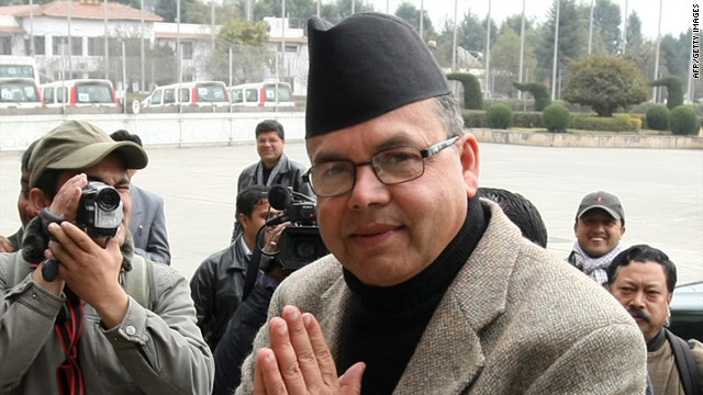 Jhala Nath Khanal, chairman of the Communist Party of Nepal, arrives at parliament in Kathmandu on Wednesday.