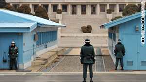 Soldiers from South Korea, right, and North Korea guard their respective side of the DMZ, separating the two Koreas.