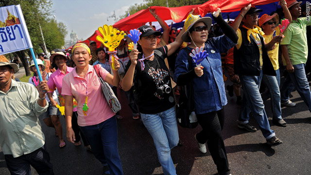 "Crowds of hundreds of yellow-shirted protesters shouted ""get out Abhisit"" as they marched through Bangkok on Friday."