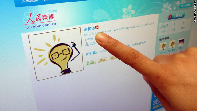 An Internet user points to the account page of China's President Hu Jintao on a microblog operated by the official People's Daily.