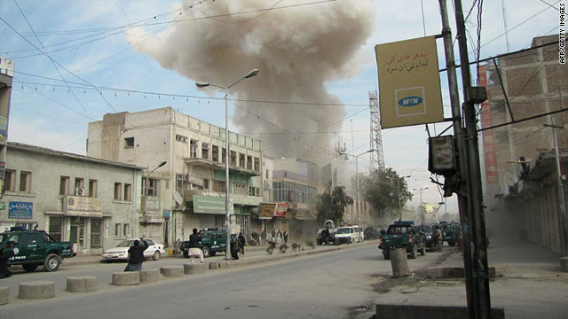 Smoke rises from a branch of Kabul Bank in Jalalabad after an attack by three Taliban suicide bombers, February 19, 2011.