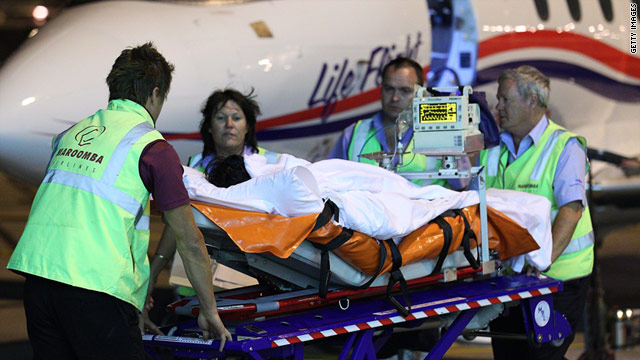 An injured survivor of the Christmas Island boat wreck arrives at the Perth Airport on December 16, 2010.