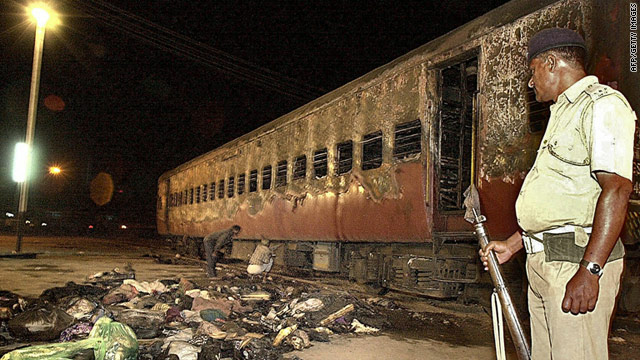 A file picture from February 28, 2002, showing the burnt out train coach. The arson attack sparked widespread riots.