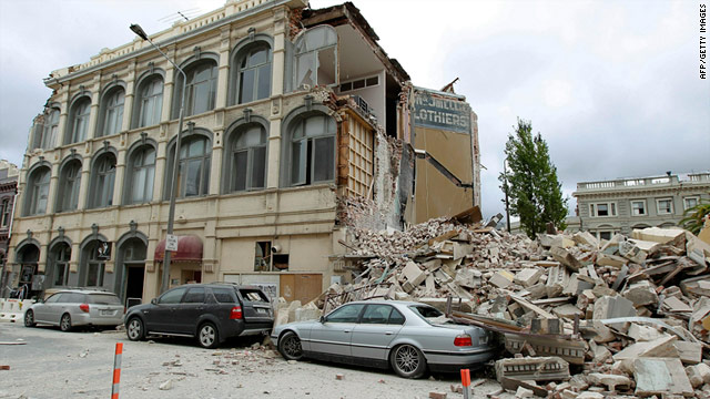 Cars sit under rubble in central Christchurch following the 6.3-magnitude earthquake on the afternoon of February 22.