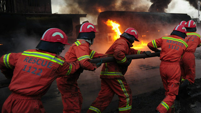 Pakistani firefighters attempt to extinguish burning NATO oil tankers on the outskirts of Peshawar on February 25, 2011.