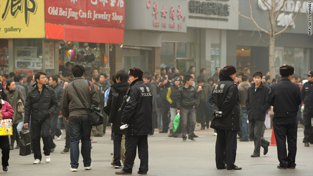 Casual observers and police outnumbered demonstrators during pro-democracy protests in Beijing on Sunday, February 20