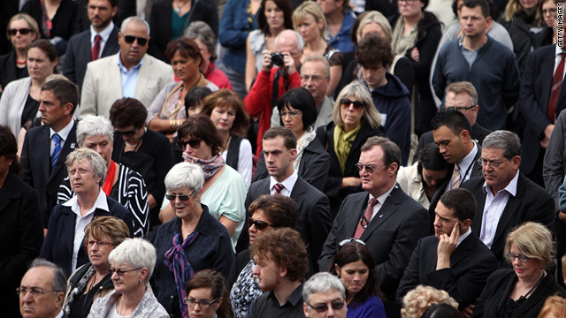 Members of the public come together as New Zealand holds two minutes' silence at 12.51p.m. local time to mark the time of last week's Christchurch earthquake at Parliament on March 1.