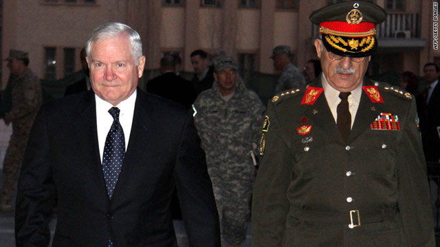 US Defence Secretary Robert Gates is escorted by Afghan Chief of Staff Lt. General Shir Mohammad Karimi.