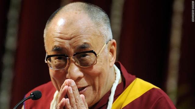 Tibetan spiritual leader the Dalai Lama gestures as he speaks during a students gathering at the Mumbai University in Mumbai on February 18, 2011.