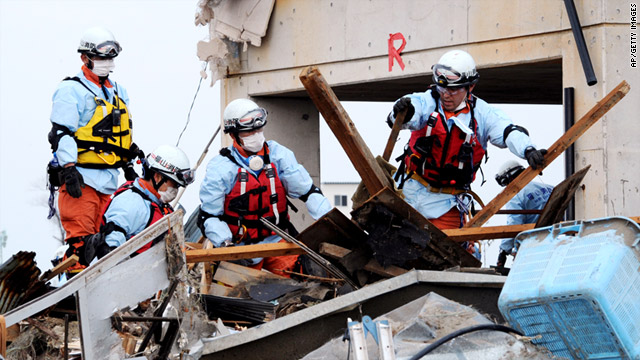 Rescue teams work urgently in Japan.