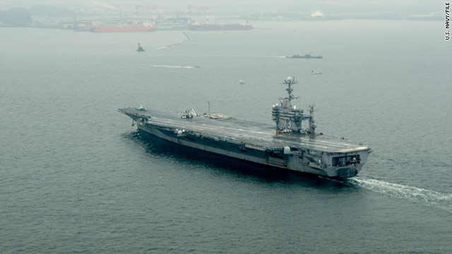 The USS George Washington, seen returning to Yokosuka, Japan, in December, detected low levels of radioactivity on Tuesday.
