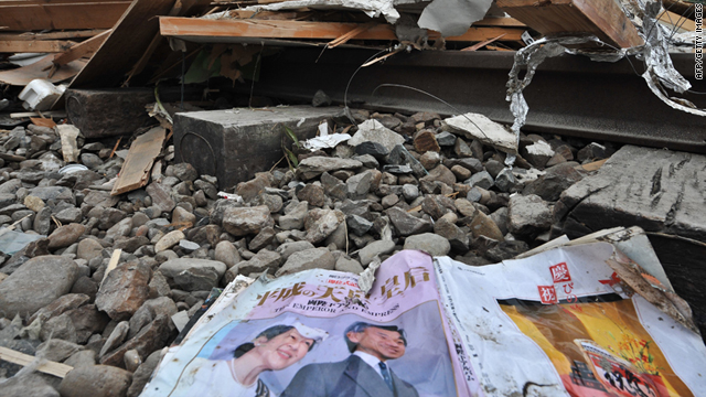 A magazine featuring Japanese Emperor Akihito and Empress Michiko is seen in the rubble in Ofunato on Tuesday.