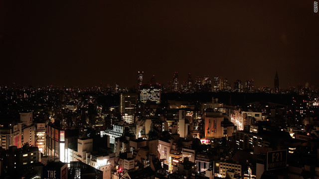A general view of a darkened Tokyo skyline March 15 during peak hour power cuts forced by the quake and tsunami.