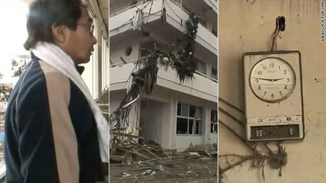 Atushi Asokawa goes through the wreckage of Togura Elementary School, smashed by Friday's tsunami. A school clock is frozen the moment the earthquake hit.