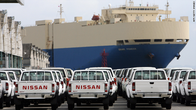 Nissan Motors' pickup trucks line up for export to the Middle East area as a freighter approaches to the Nissan pier at the Yokohama port, Kanagawa prefecture, 15 September 2006.