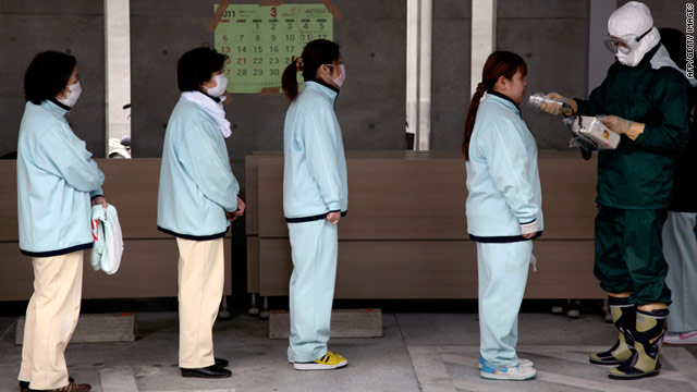 People line up for radiation screening at Koryama in Fukushima prefecture on Monday.