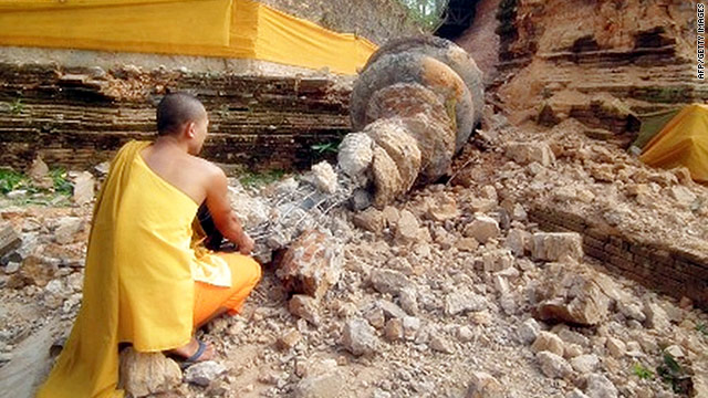 A Thai Buddhist monk inspects a fallen stupa of the Chedi Luang pagoda a day after a strong earthquake hit Myanmar.