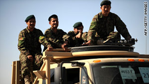 Afghan National Army soldiers ride in the back of a truck in Kandahar province, southern Afghanistan on March 23.